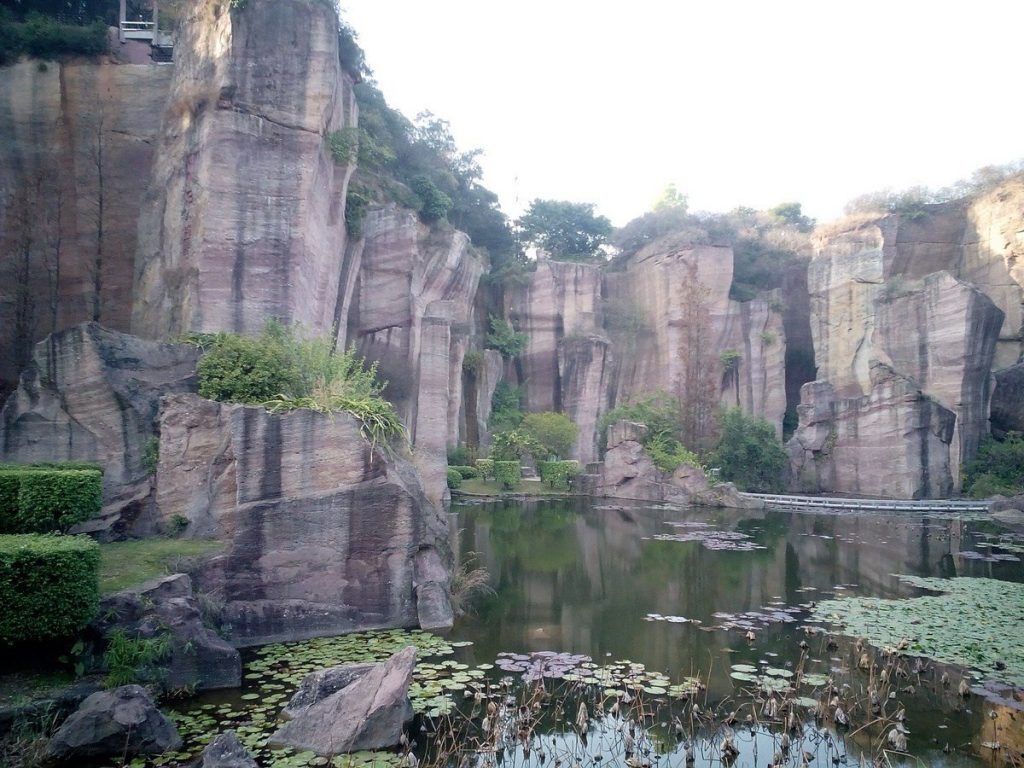 Lotus hill-mountain-china-ancient-quarry-cliffs-lake